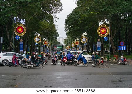 Ho Chi Minh City, Vietnam - August 23, 2017: Moving Traffic Crossing The Street During Rush Hour In