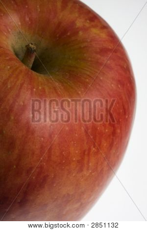 macro of red Fuji apple on white background selective focus poster