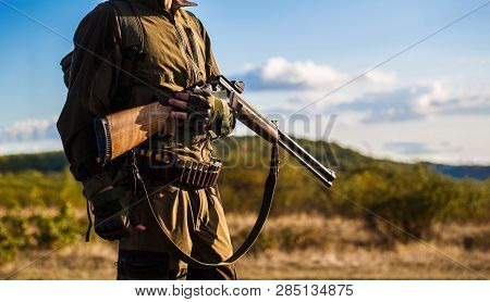 Hunter Man. Hunting Period, Autumn Season. Male With A Gun. Hunter With A Backpack And A Hunting Gun