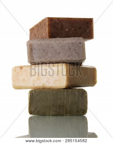 A Collection Of Handmade Soap With Different Flavors Isolated On White Background