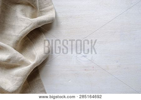 Bottom Linen Fabric Border In A Natural Neutral Woven Material Over Painted White Wood