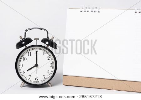 Blank Paper Spiral Calendar For Mockup Template Advertising And Branding With Clock On Gray Backgrou