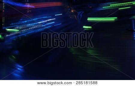 Night Colors Of The Amusement Park Lights Moving, Light Trails, Slow Shutter-speed