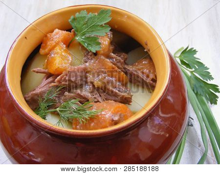 Stewed Rabbit With Vegetables, Venison Goulash In Copper Pot On Wooden Surface, Roasted Beef Meat Wi