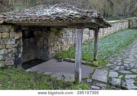 Small corner with roof oven sacred spring source in Demir Baba Teke, cult monument honored by both Christians and Muslims in winter near Sveshtari village, Municipality Isperih, Razgrad District, Northeastern Bulgaria poster