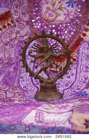 Bronze Shiva on purple - lavendar Rajasthani textile backdrop made from saris. Nataraja (Sanskrit: Lord of Dance) Shiva represents apocalypse and creation as he dances away the illusory world of Maya transforming it into power and enlightenment. poster