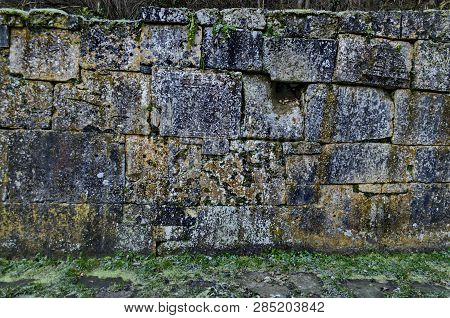 Part of the stone fence with ancient ritual stones and frescoes in Demir Baba Teke, cult monument honored by both Christians and Muslims in winter near Sveshtari village, Isperih, Razgrad, Northeastern Bulgaria poster