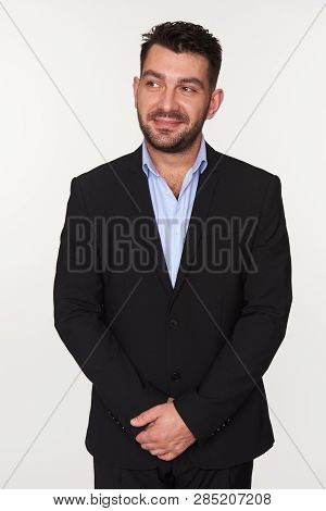 Bearded Man In Black Suit Looking Away