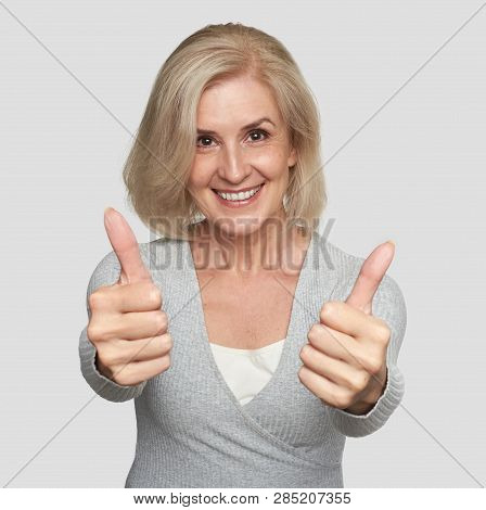 Excited Mature Woman Showing Thumbs Up