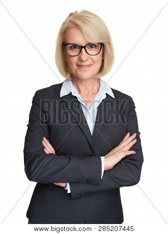 Cheerful Mature Businesswoman Wearing Glasses
