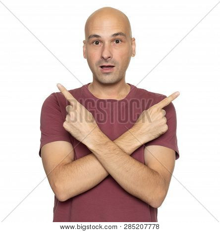 Puzzled Bald Man Pointing Different Directions