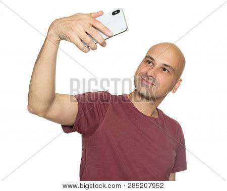 Man Takes Selfie On His Smartphone. Isolated