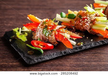 Concept Of European Cuisine. Snack For Wine. Raw Veal Roll With Crispy Vegetables, Cucumber, Celery,