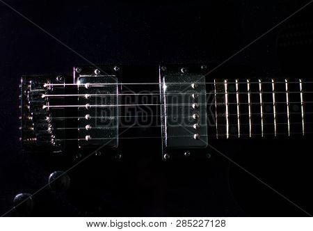 Electric Guitar Closeup On Black Background. Metal.