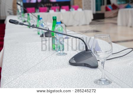 Microphone In The Empty Conference - Meeting Room . Intercom In The Classroom. Table Microphone On T