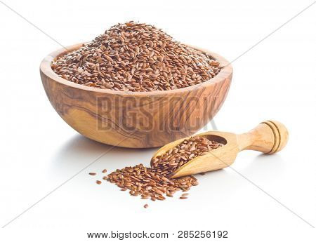 Flax seeds, linen seeds or linseeds in scoop isolated on white background.