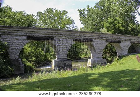 5 Arch Bridge In Avon, Ny. Historic Limestone Railroad Bridge Over The Conesus Outlet Built By The G