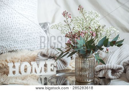 Still Life With A Wooden Inscription Home And A Vase Of Flowers