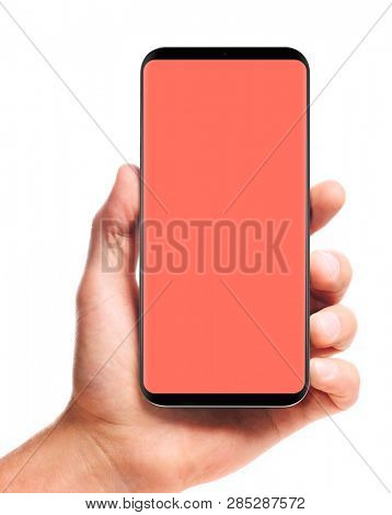 male hand holding bezel-less smartphone with blank living coral screen, isolated on white background . Screen is cut out with path