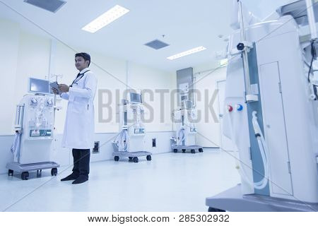 Doctor With Modern Equipment In The Hospital,doctor Using Digital Tablet Against Equipment,equipment