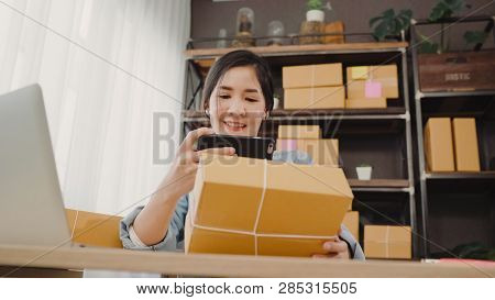 Beautiful Smart Asian Young Entrepreneur Business Woman Owner Of Sme Checking Product On Stock Scan