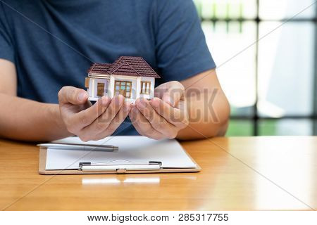 Homeowners Selected Refinancing Of House And Checking Interest Rates And Monthly Payments. Home Mort