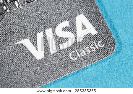 New York, Usa - February 17, 2019: Credit Visa Card Close-up. Visa Classic Card Type On Blue Backgro