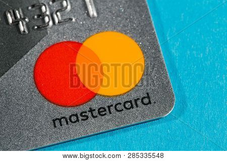 New York, Usa - February 17, 2019: Credit Master Card Close-up. Master Card On Blue Background.