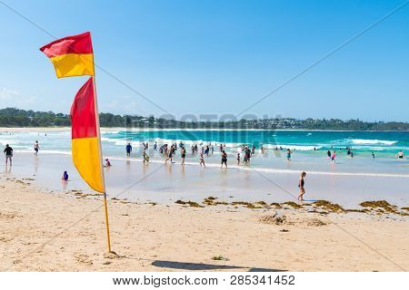 People Enjoying The Sunny Weather At Mollymook Beach, A Wonderful Seaside Escape And Perfect Getaway