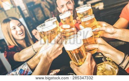 Friends Drinking Beer At Brewery Bar Restaurant On Weekend - Friendship Concept With Young People Ha
