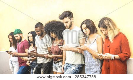 Multiracial Friends Using Mobile Smartphone At University Coampus - Millenial People Addicted By Sma
