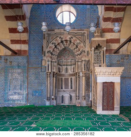 Cairo, Egypt - January 8 2019: Blue, Iznik Ceramic Tiles Wall With Engraved Mihrab (niche) And Decor