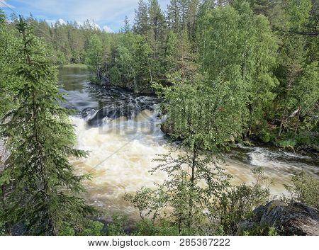 Majestic Myllykoski Rapids At The Oulanka National Park In Kuusamo, Finland. Green Forest Framing Th