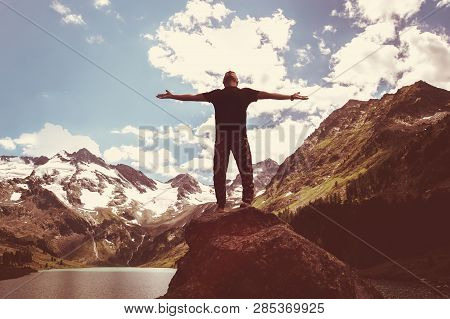 Freedom. Free Man With Open Arms On Sunset. Success. Travel. Good Life. Backpacker, Hiking The Conqu