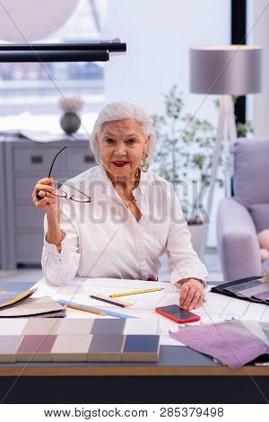 Beauteous Aging Executive Comely Sitting At Deluged With Papers Table