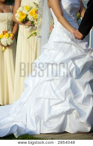 Brides Dress During The Wedding Ceremony