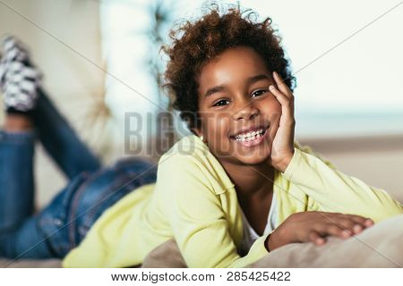 Cute Funny Little African American Girl Looking At Camera, Smiling Mixed Race Child Posing For Portr