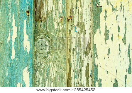 Peeling paint texture. Texture wooden background of old wooden planks with peeling paint, flaked paint texture background. Closeup of peeling paint, peeling paint on the texture wooden surface