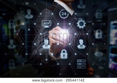 A Confident Businessman Is Pressing A Shield Inside A Digital Social Network System With Icons And S