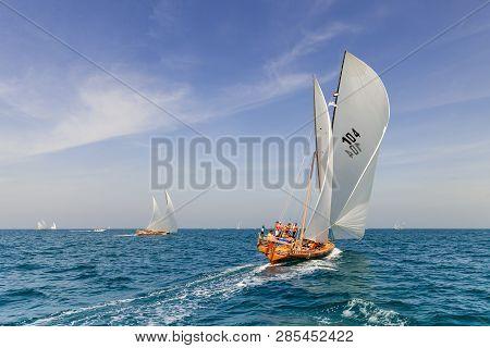 ABU DHABI, UAE - FEBRUARY 10, 2018: Sailing dhow race back to Abu Dhabi at 60 Feet Dhow Sailing Race