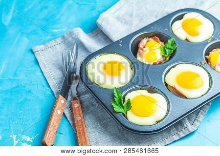Baked Eggs  In Baking Molds. Portioned Casserole From Bacon Sowbelly And Eggs In Italian Style.