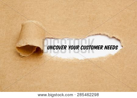 Text Uncover Your Customer Needs Appearing Behind Torn Paper. Concept About The Importance To Unders