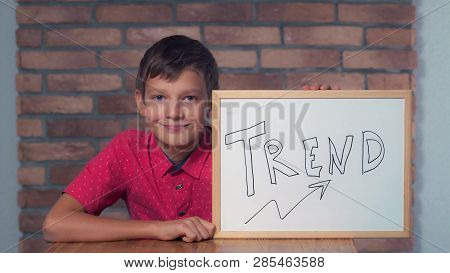Portrait Little Boy Showing Whiteboard With Handwriting Trend. Child Smiling Looking At Camera . Pre