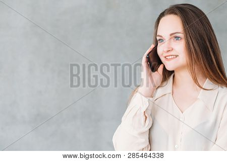 Business Matters. Discussion And Communication. Smiling Beautiful Woman Talking On Phone. Copy Space