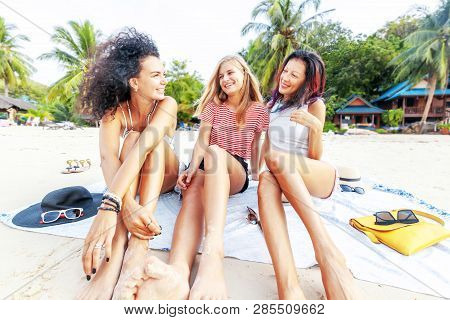 Three Young Beautiful Girlfriends Relax And Have Fun On A Tropical Beach, Travel And Vacation Concep