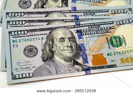 A Bundle Of Hundred Dollar Bills Laid Out Like A Fan. On A White Background. Background Of Dollar Bi