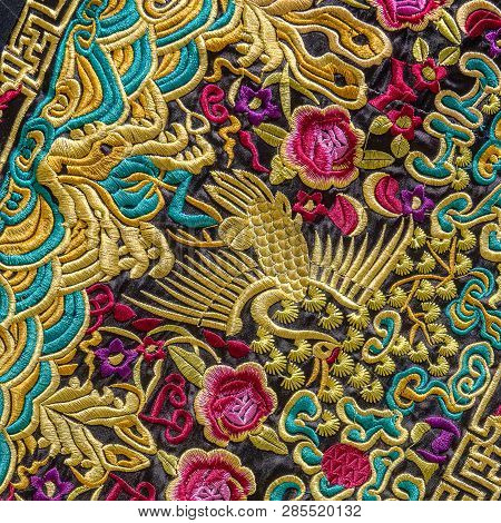 Close up of Chinese embroidery. This is an example of the craftsmanship of the Chinese for this embroidery. Everything is made by hand and a lot of gold color is used. poster