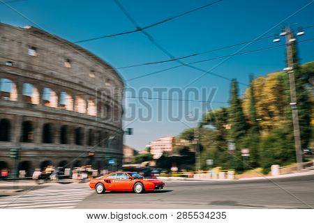 Rome, Italy - October 21, 2018: Red Ferrari Mondial Coupe In Fast Motion Near Colosseum.