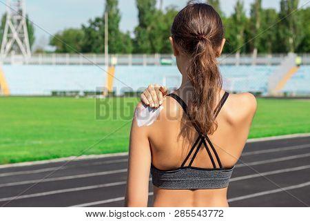 Sunscreen Sunblock. Woman In A Sportswear Putting Solar Cream On Shoulder On Beautiful Summer Day. S