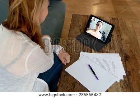 Beautiful Freelance Woman Consultant Having A Video Conference Call With Online Client At Home
